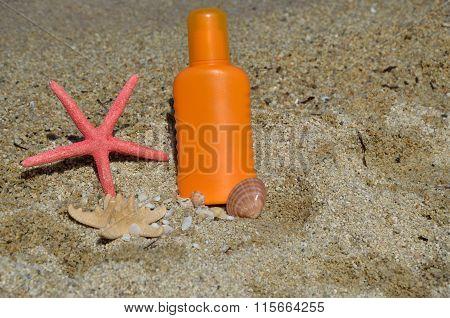 Sun Lotion On Beach Sand