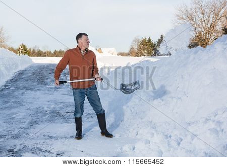 Senior Adult Man Finishes Digging Out Drive In Snow