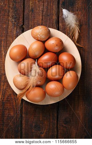 eggs on wooden plate, top view