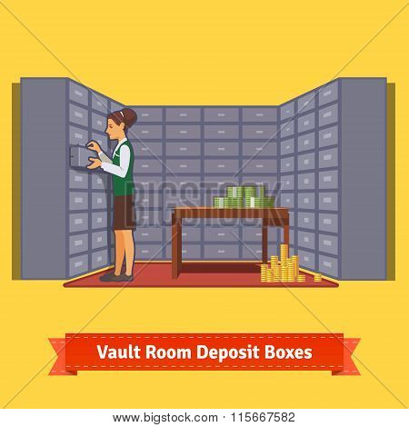 Bank vault room with a clerk and deposit boxes