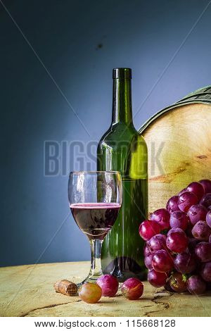 Glass Of Red Wine On A Wooden