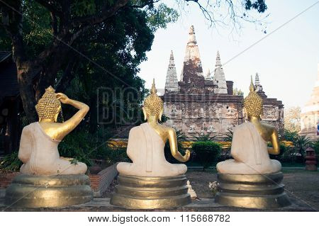 Three Outdoor Buddhas Front Of The Maha Chedi Of Wat Chet Yot Temple In Thailand.