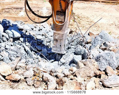 Destroying reinforced concrete structures with hammer hydraulic