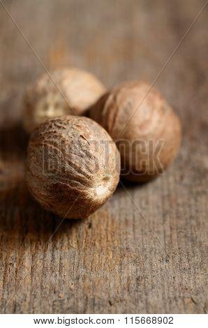 Nutmeg On Wooden Table
