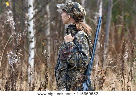 Woman Hunter In Camouflage In The Forest