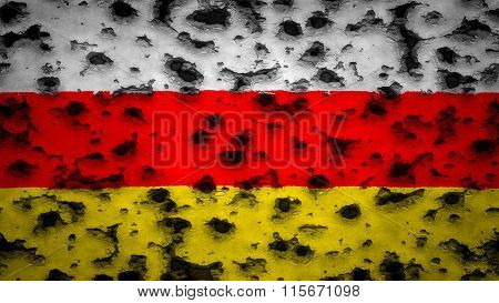 Flag of South Ossetia painted on wall with bullet holes