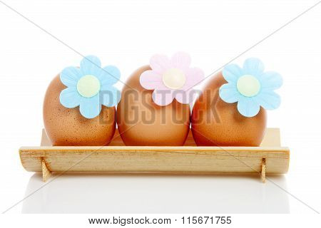 Three Eggs On Wooden Plate