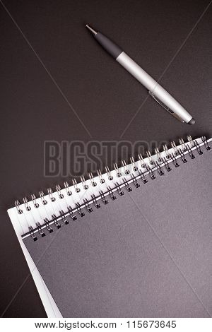 Office Supplies On Black Table