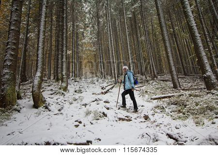 Girl Climbs The Forest Trail In The Snow. Tourism