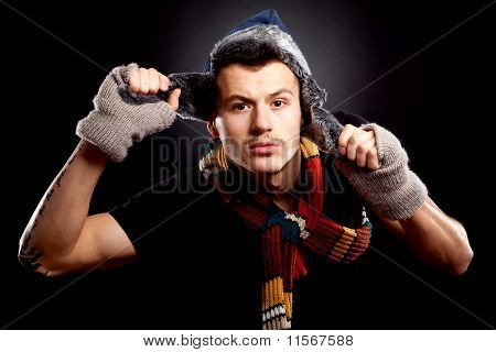 Young Man Holding A Furry Hat