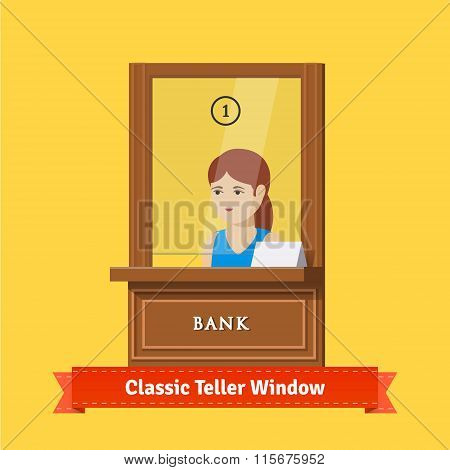 Classic bank teller window with a working clerk
