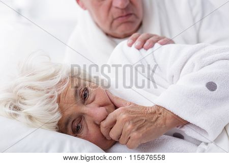 Ill Woman Coughing In Bed