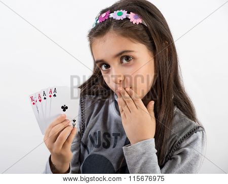 Secretive Young Girl Showing Her Poker Hand