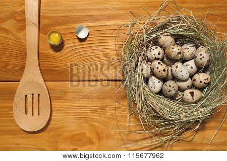 The Composition Of Quail Eggs In A Nest From Grass And Wooden Spoon Lying On A Panel Of Vintage Brow
