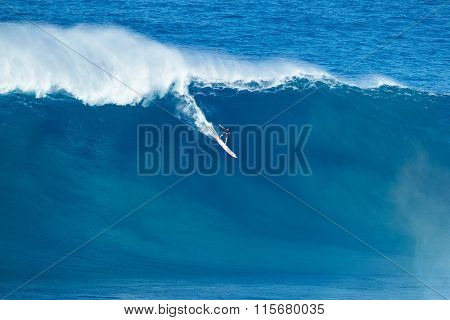 MAUI, HI - JANUARY 16 2016: Professional surfer rides a giant wave at the legendary big wave surf break known as