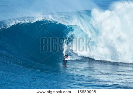 MAUI, HI - JANUARY 16 2016: Professional surfer Francisco Porcella rides a giant wave at the legendary big wave surf break known as