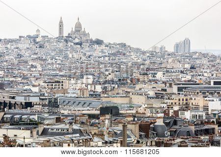 Aerial View of Paris cityscape and Sacre Coeur Cathedral on Montmartre