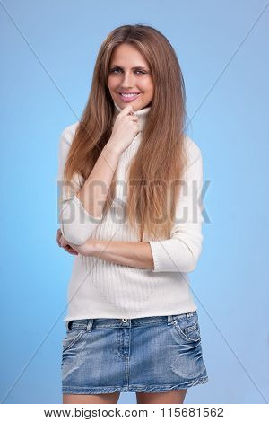 beautiful coquette young woman, isolated on blue