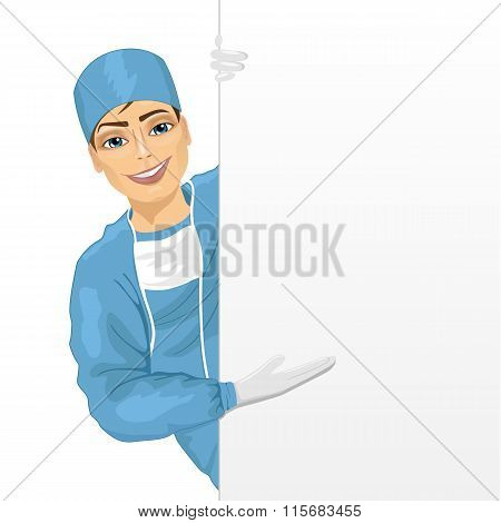 young surgeon in blue scrun suit presenting empty presentation banner