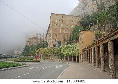 Montserrat, Spain - August 28, 2012: Misty Morning In The Benedictine Abbey Santa Maria De Montserra