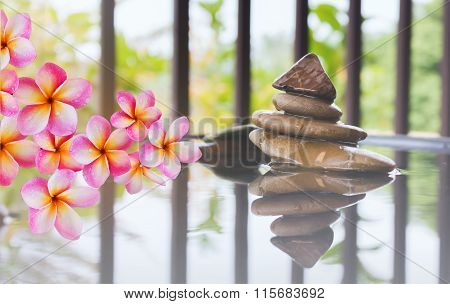 Pink Flower Frangipani Bunch And Pebble On Water In Zen Style Background