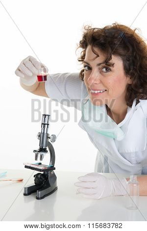 Close-up Of Laboratory Technician Putting Some Substance