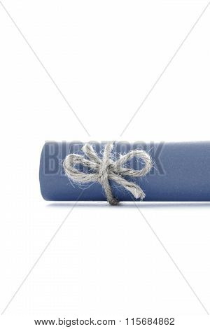 Handmade Natural Rope Knot Tied On Blue Letter Scroll Isolated