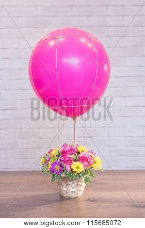 Bouquet Of Flowers In A Basket With Baloon