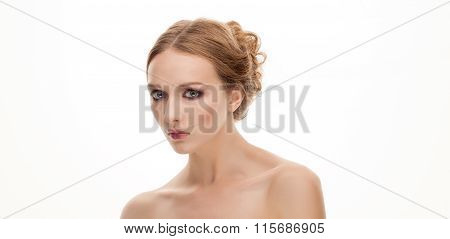Closeup beauty portrait of young adorable blonde woman with trendy makeup and bare shoulders isolate