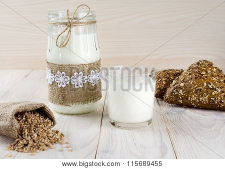 Brown Rolls With Caraway Seeds. Wheat Grains In The Pouch.