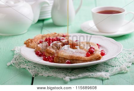 Fresh homemade crepes on plate with fresh berries