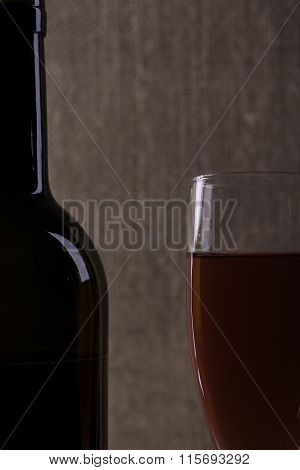 Perfect wine bottle and glass silhouette on cloth background