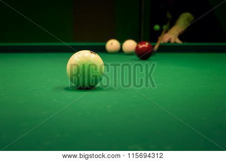 Man Playing In Pool Billiards On Green Table