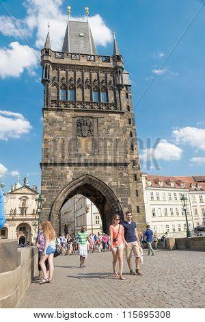 People Walking On The Famous Charles Bridge - Prague