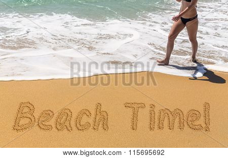 Beach Time Written In Sand With Young Woman