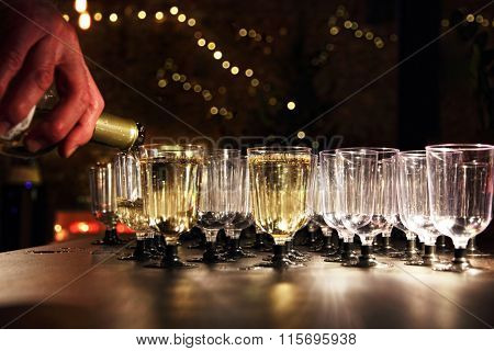 Waiter Pour Wine In The Glass On Holiday Reception Table.