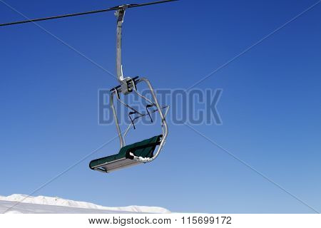 Chair-lift And Blue Sky