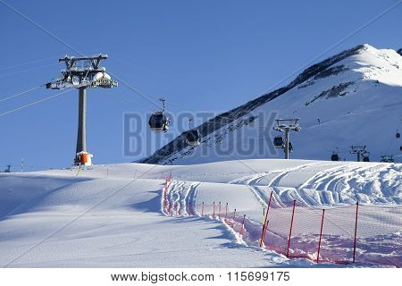 Gondola Lift On Ski Resort At Sun Day