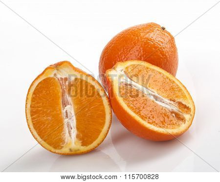 one whole and wo halves oranges isolated white