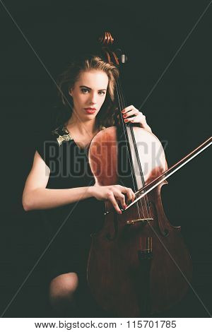 Lady Playing A Song On Cello, Looking At Camera