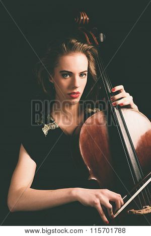 Gorgeous Young Woman Playing A Cello Instrument