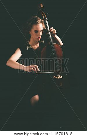 Pretty Young Woman Playing A Cello At Night