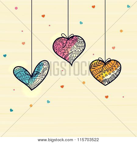 Colorful hanging floral design decorated hearts for Happy Valentine's Day celebration.