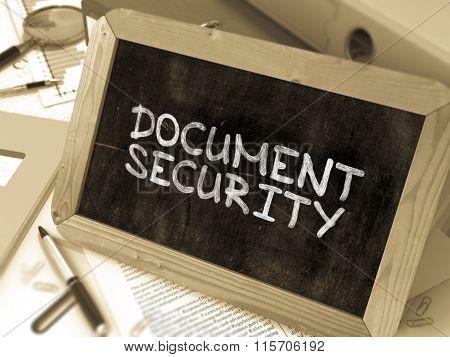 Document Security Handwritten by White Chalk on a Blackboard.