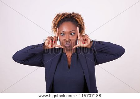 African American Business Woman Grimacing Making Frame Gesture With Her Hands