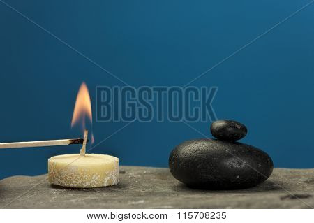 Lighting A Tea Candle.