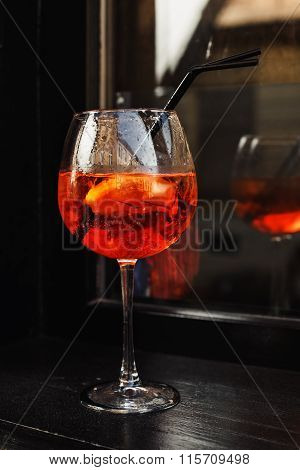 Red wine glass on the wooden table