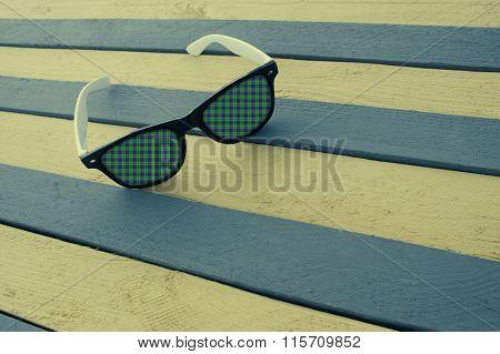 Creative Sunglasses On A Striped Surface