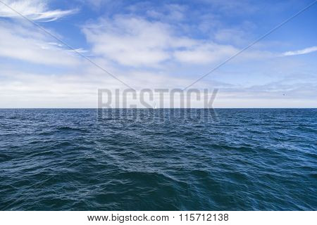 Isolated Yacht Sailing In The Blue Atlantic Ocean Near Monterey, California