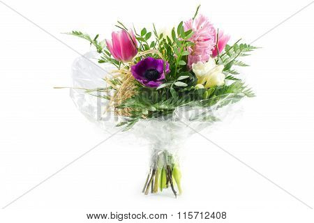 Bouquet In Cellophane With Pink And Purple Flowers, Isolated On White